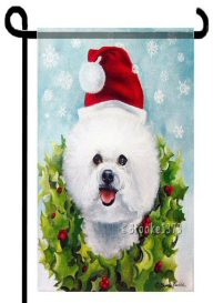 Bichon Frise catching snowflakes garden flag with Christmas wreath of holly and aqua blue background. Cute dog wearing a Santa hat on this adorable garden flag