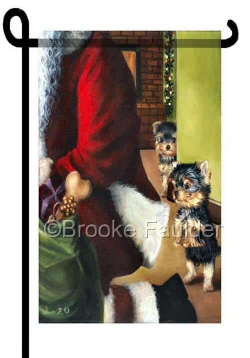 Two yorkie puppies watch as Santa unloads his pack. in this Christmas garden flag, 12 x 18 inches, flag stand not included.