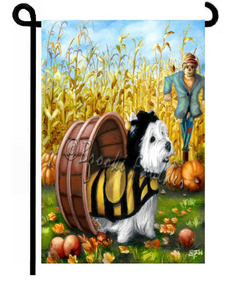 Westie wears Halloween bee costume with apples, cornfield, scarecrow