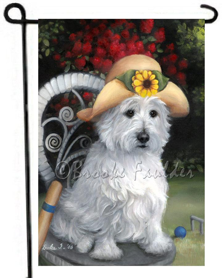 summer West Highland Terrier on wicker chair