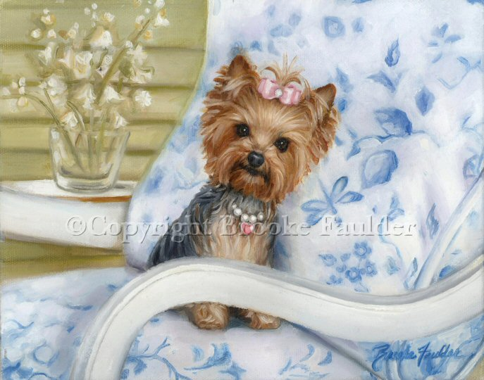 a serene and tranquil setting with a Yorkie wearing her pretty pink heart necklace and pink top knot, sitting on a patio chair.