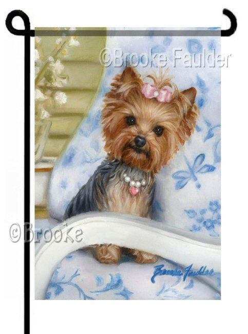 A Quiet Setting, Yorkshire Terrier garden flag 12x18 inches. One Small Yorkie or Yorkie puppy sitting on a blue print patio chair with dragonfly, flower pattern. The yorkie wears a pearl and heart necklace with pink topknot. Great gift for Yorkie lover!