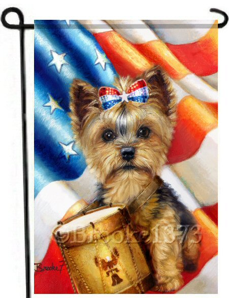 Red, white and blue patriotic yorkie named Liberty wears a drum and sequined patriotic top knot in this garden flag perfect for your Independence day garden decor. The american flag flies freely in the background. Art by Brooke Faulder.