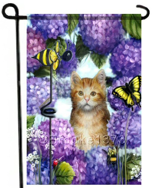 Yellow kitten in cute spring garden flag with purple and violet hydrangeas. 12 x 18 garden flag is weather and UV resistant and printed on both sides.