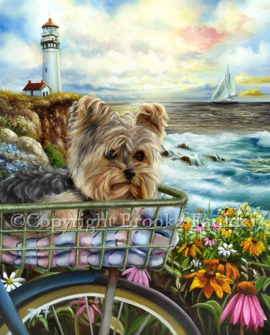 A yorkie puppy riding in the basket of a bike in front of the ocean. A lighthouse, wavas crashing, a sailboat and lots of pretty wildflowers under the colorful morning sky in this Yorkshire Terrier dog art.